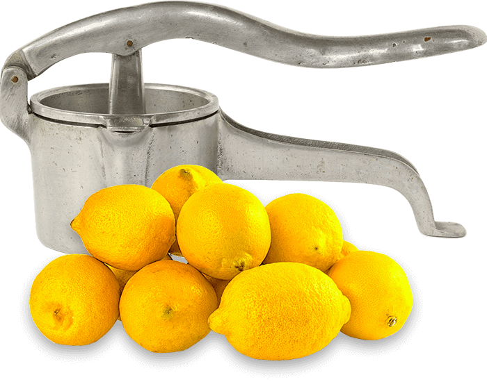 Old fashioned lemon press with fresh lemons