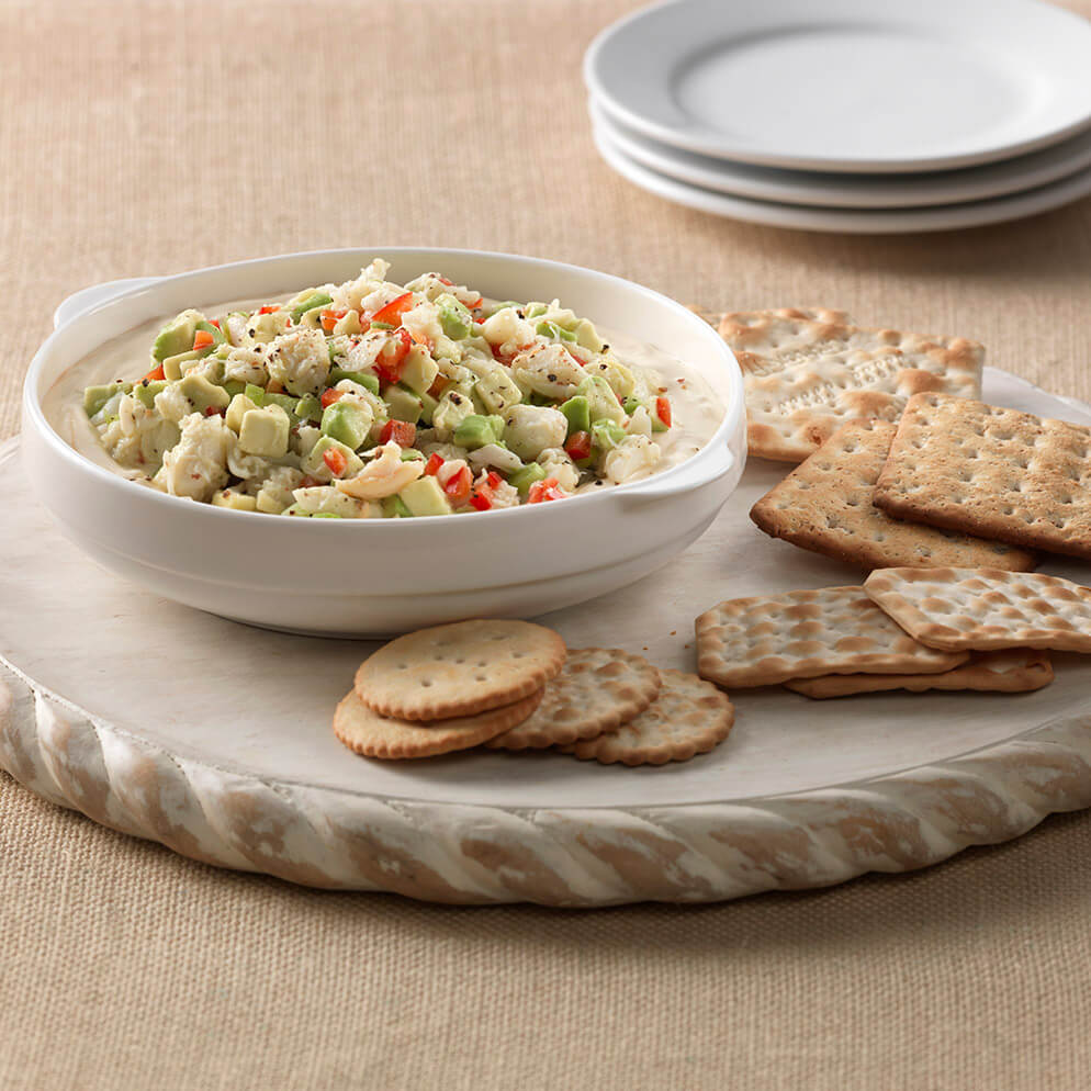 Avocado Crab Dip on platter with crackers recipe made with ReaLemon