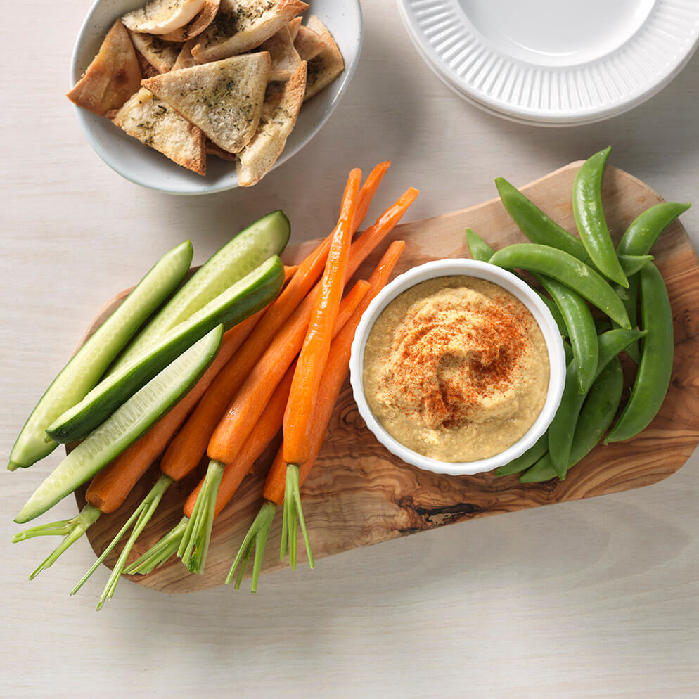 Classic Hummus in bowl on platter with cut veggies recipe made with ReaLemon