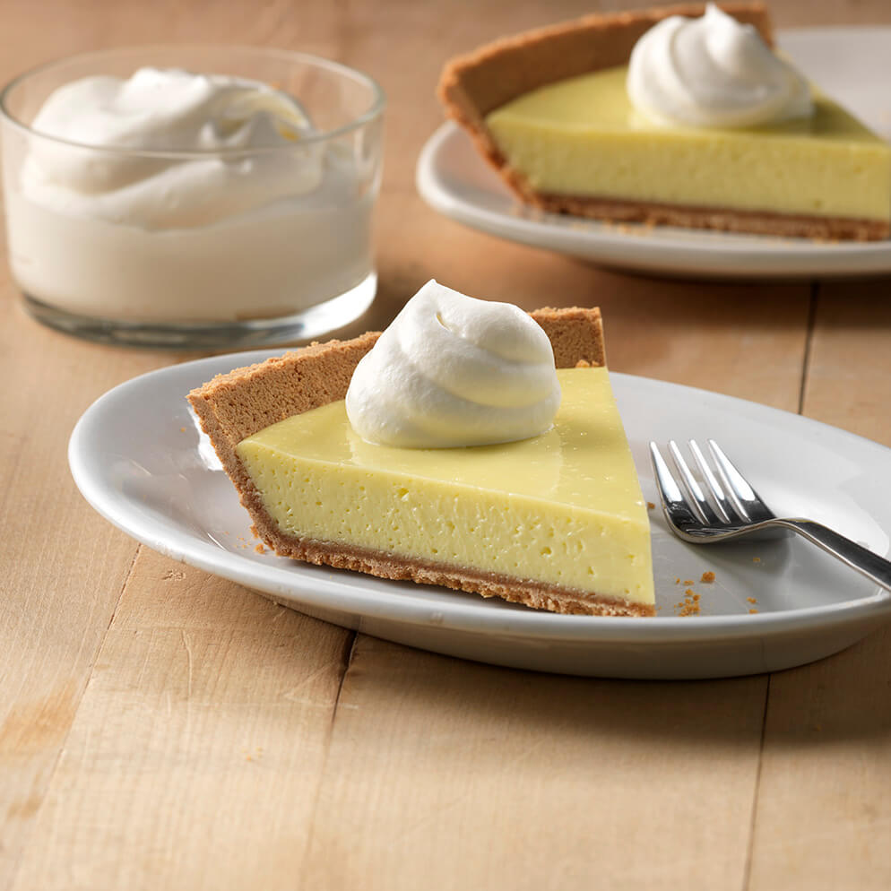 Creamy Key Lime Pie sliced on plate recipe made with ReaLime