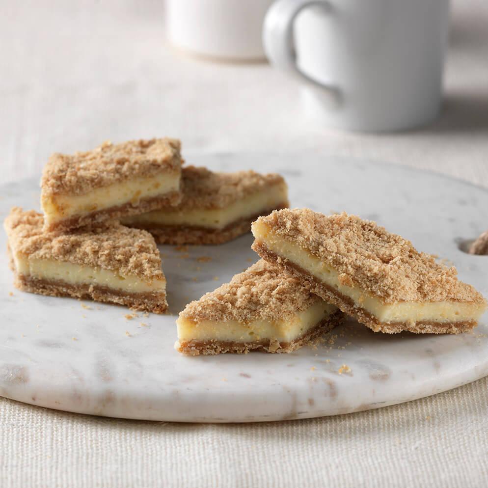 Heavenly Lemon Dessert Squares on platter recipe made with ReaLemon