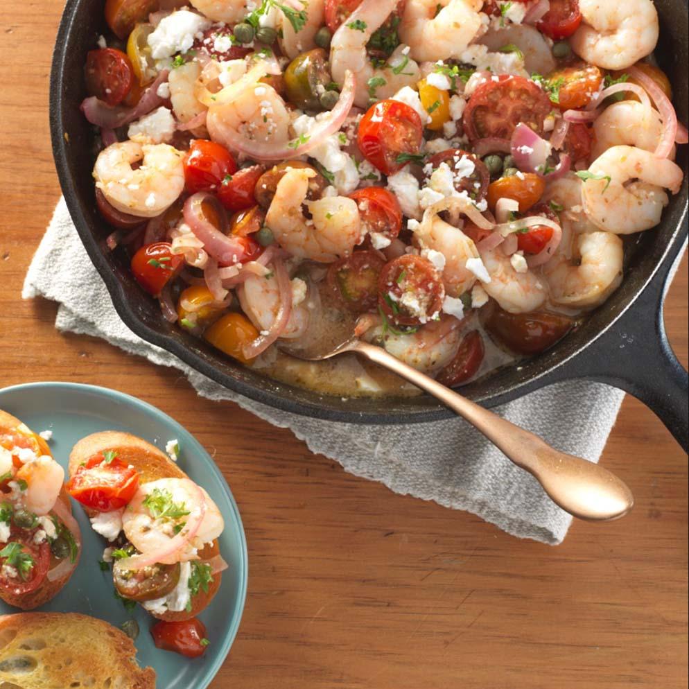 Lemon Roasted Tomatoes, Shrimp & Feta appetizer in skillet recipe made with ReaLemon
