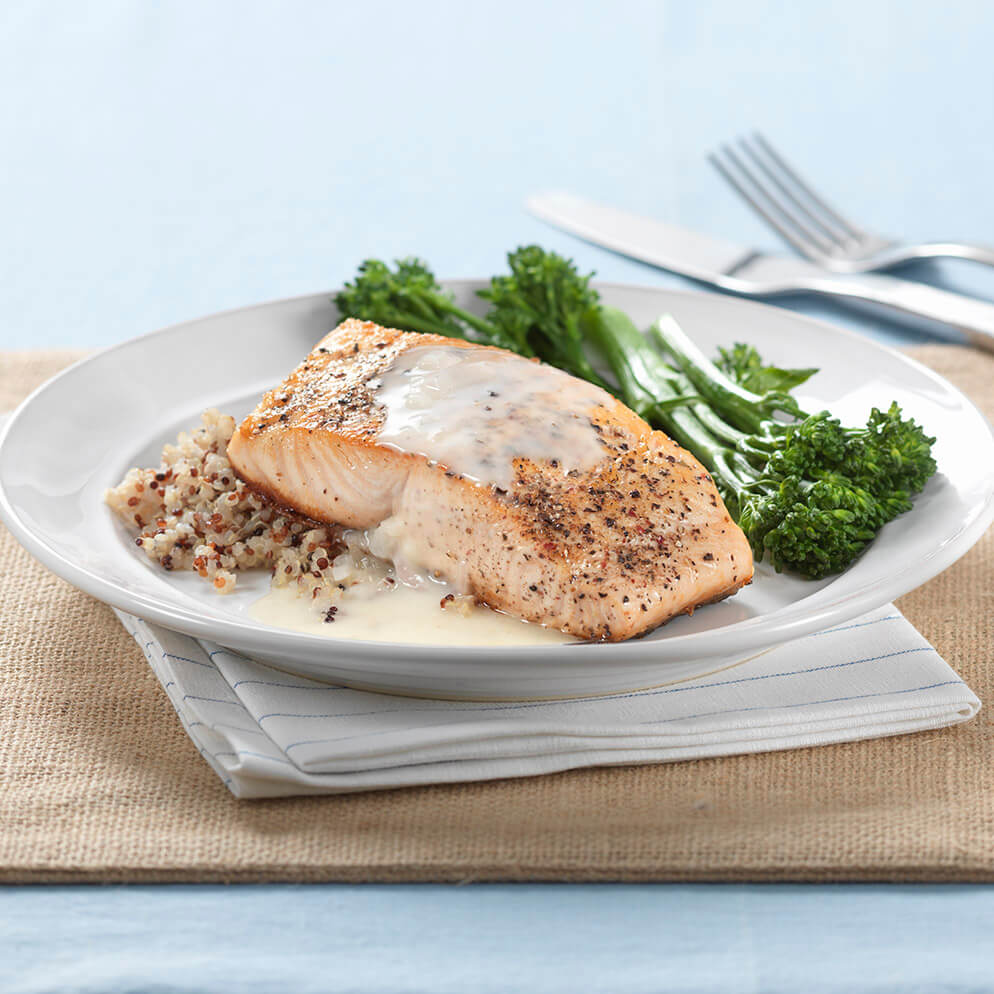 Salmon with Lemon Butter Sauce on plate recipe made with ReaLemon