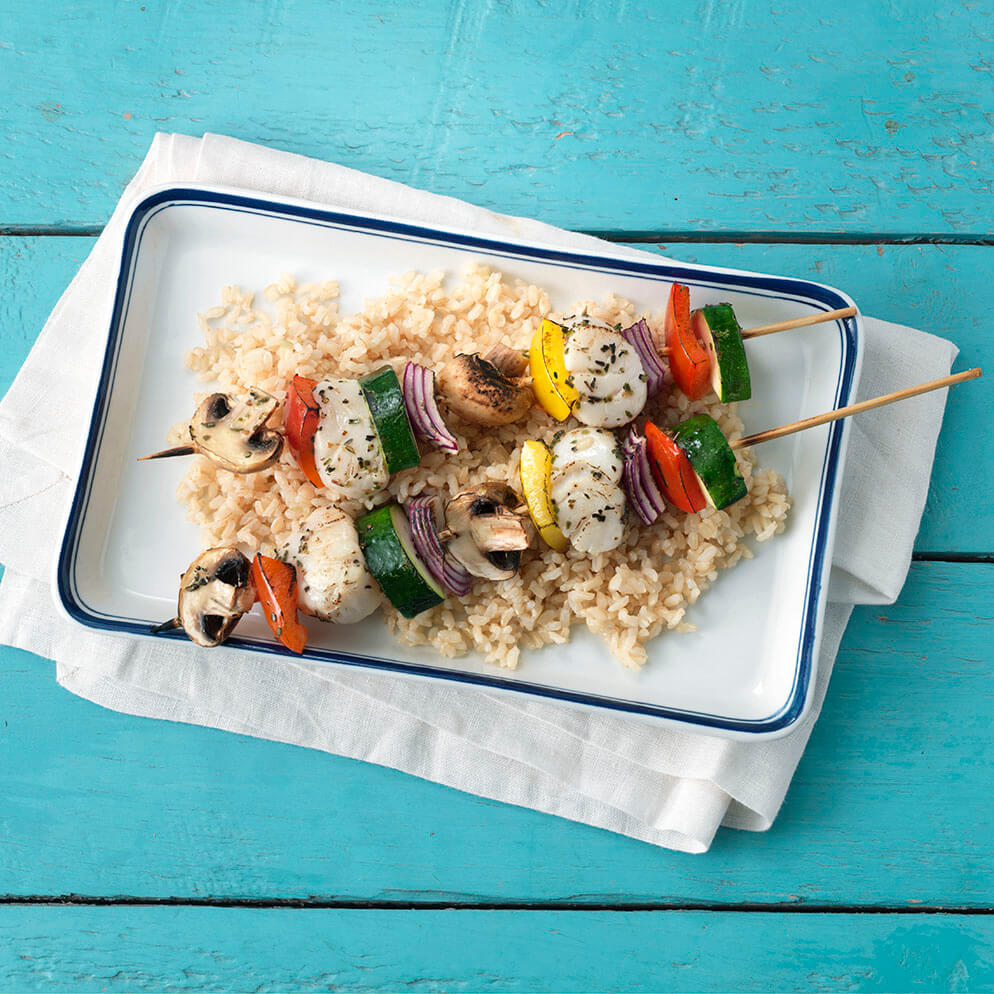 Scallop Kebabs on platter with veggies and rice recipe made with ReaLemon