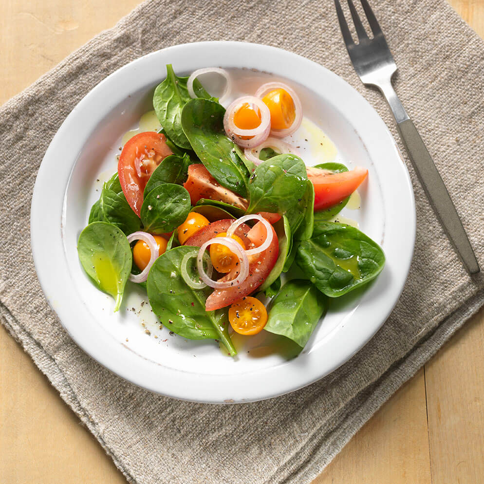 Tomato Salad with Honey-Lime Vinaigrette on plate recipe made with ReaLime