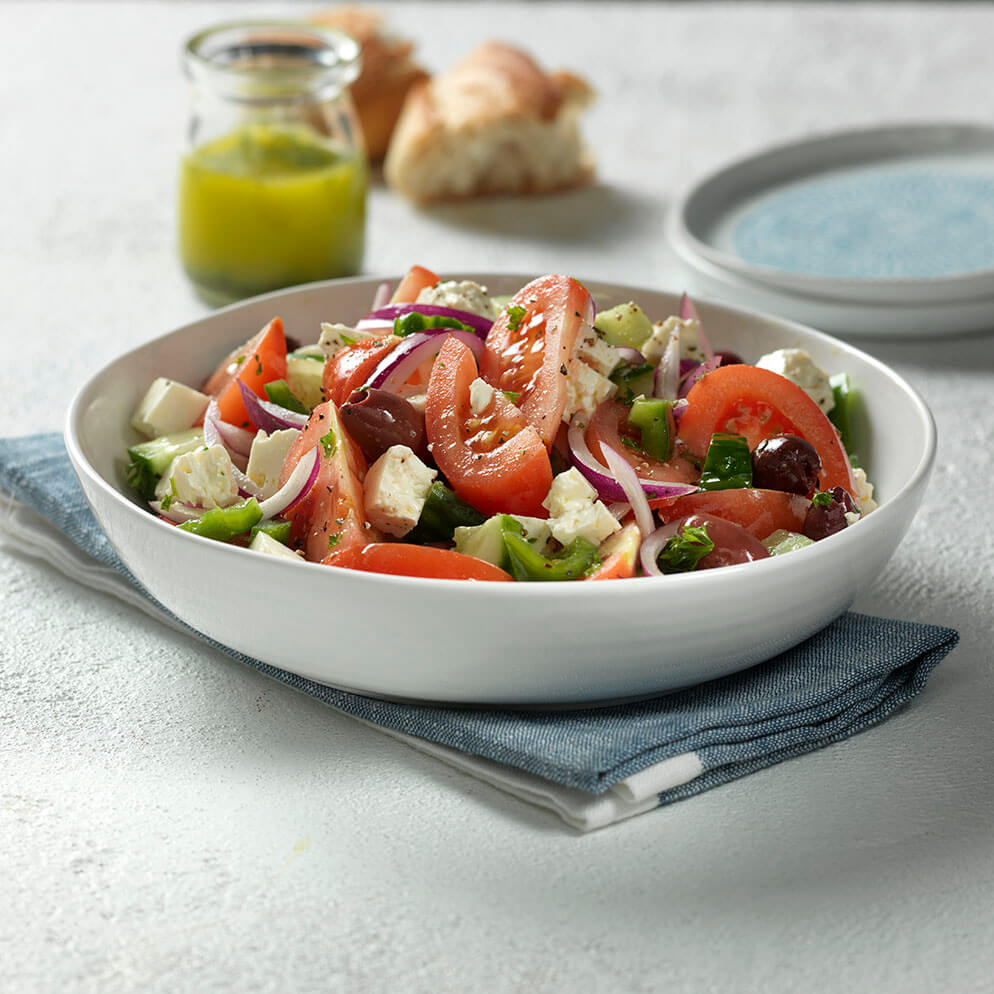 True Greek Salad in bowl recipe made with ReaLemon